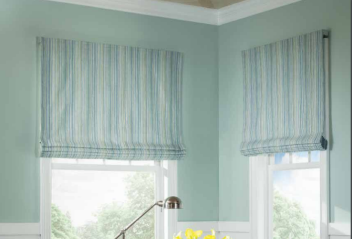 Flat Fold Roman Shade over two windows in a room corner