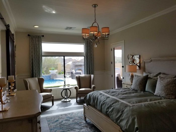 bedroom with window overlooking a pool