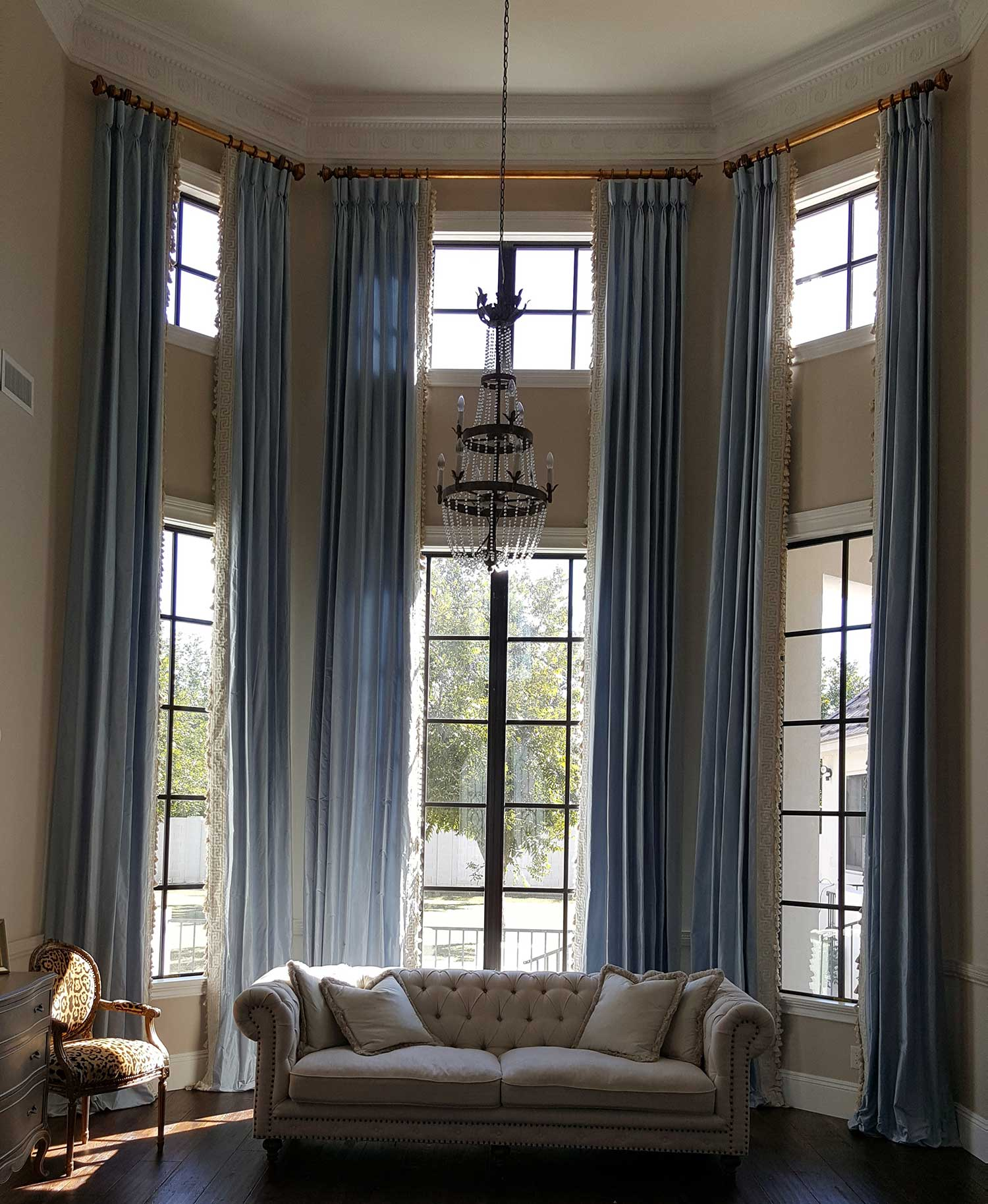 large, angled windows in a corner of a living room