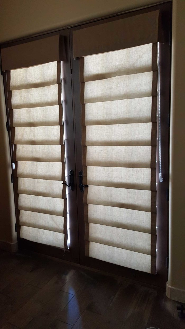 Hobbled Roman Shades over a window
