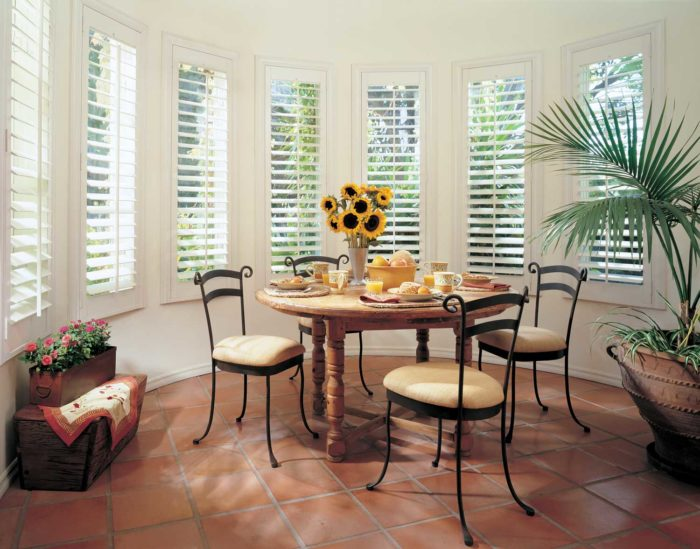 shutters in gilbert, az - shuttered, circular windows around a dining space