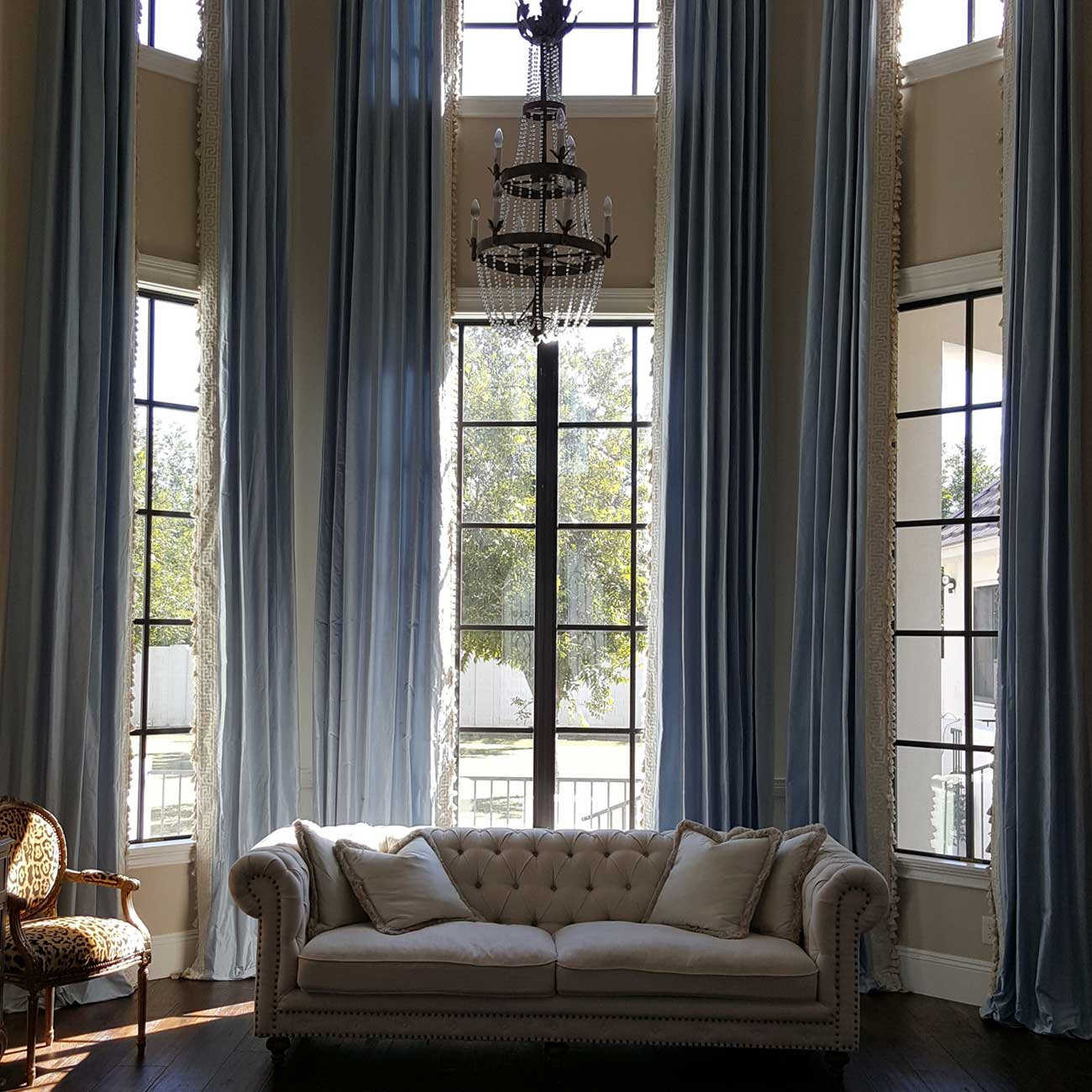 Blue curtain and white couch