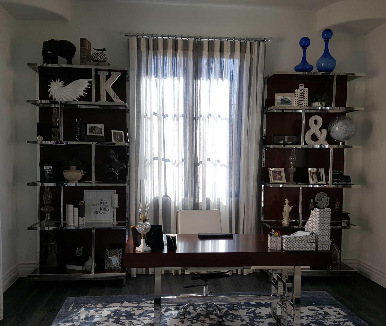 window in-between shelves with knick knacks
