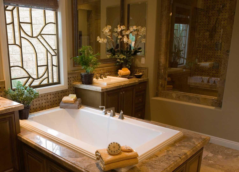 bathtub set in marble flooring, in a decorated bathroom