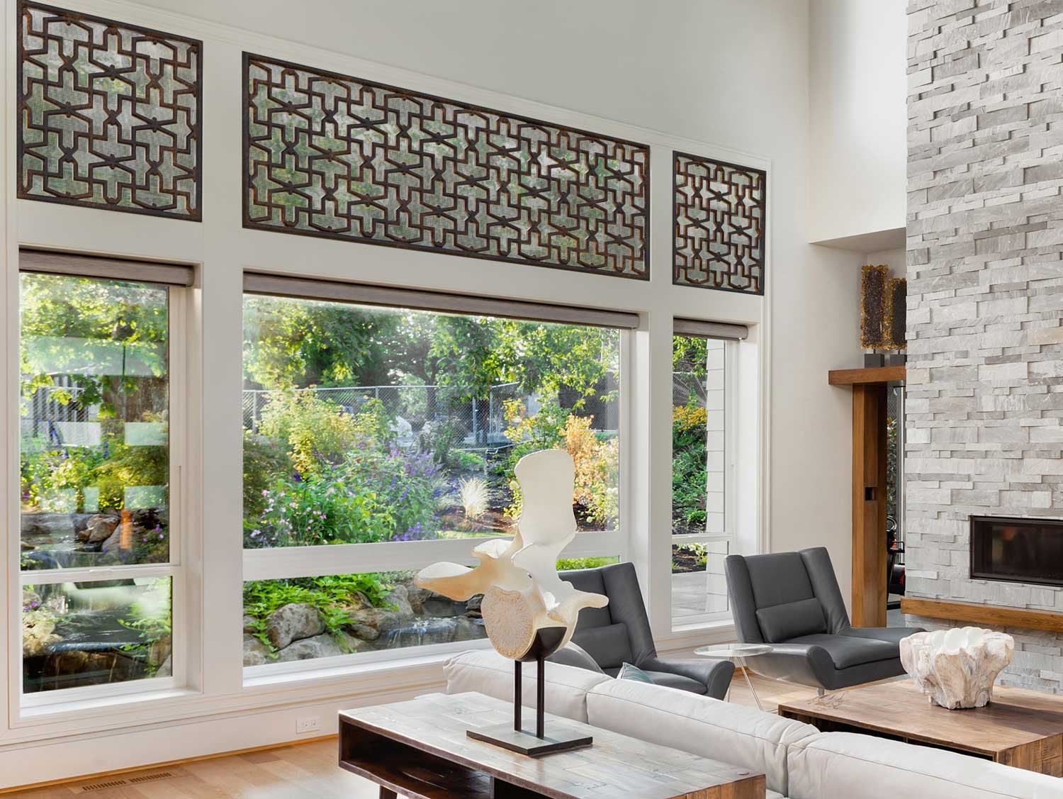 living space with wide window-views into a green garden