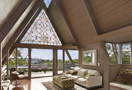 tableaux window treatment ideas - interior of a living space with slanted roof