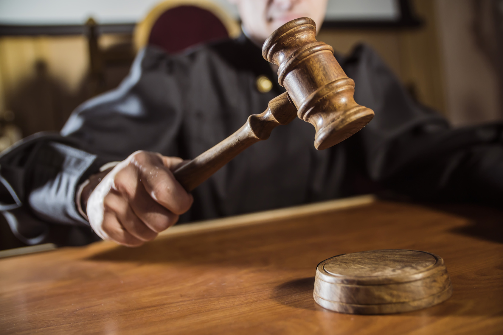 judge with gavel presiding over court case