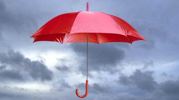 red umbrella against cloudy sky