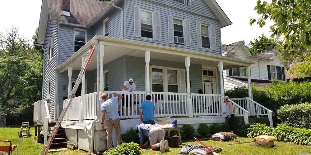 volunteers working on the house