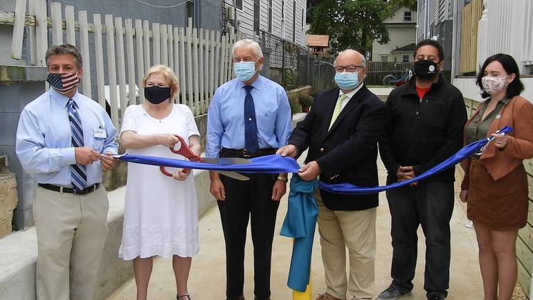 Ribbon cutting for the completed River Avenue extension