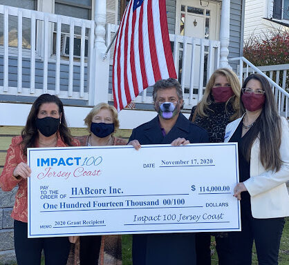 HABcore with a big check from the Impact 100 grant