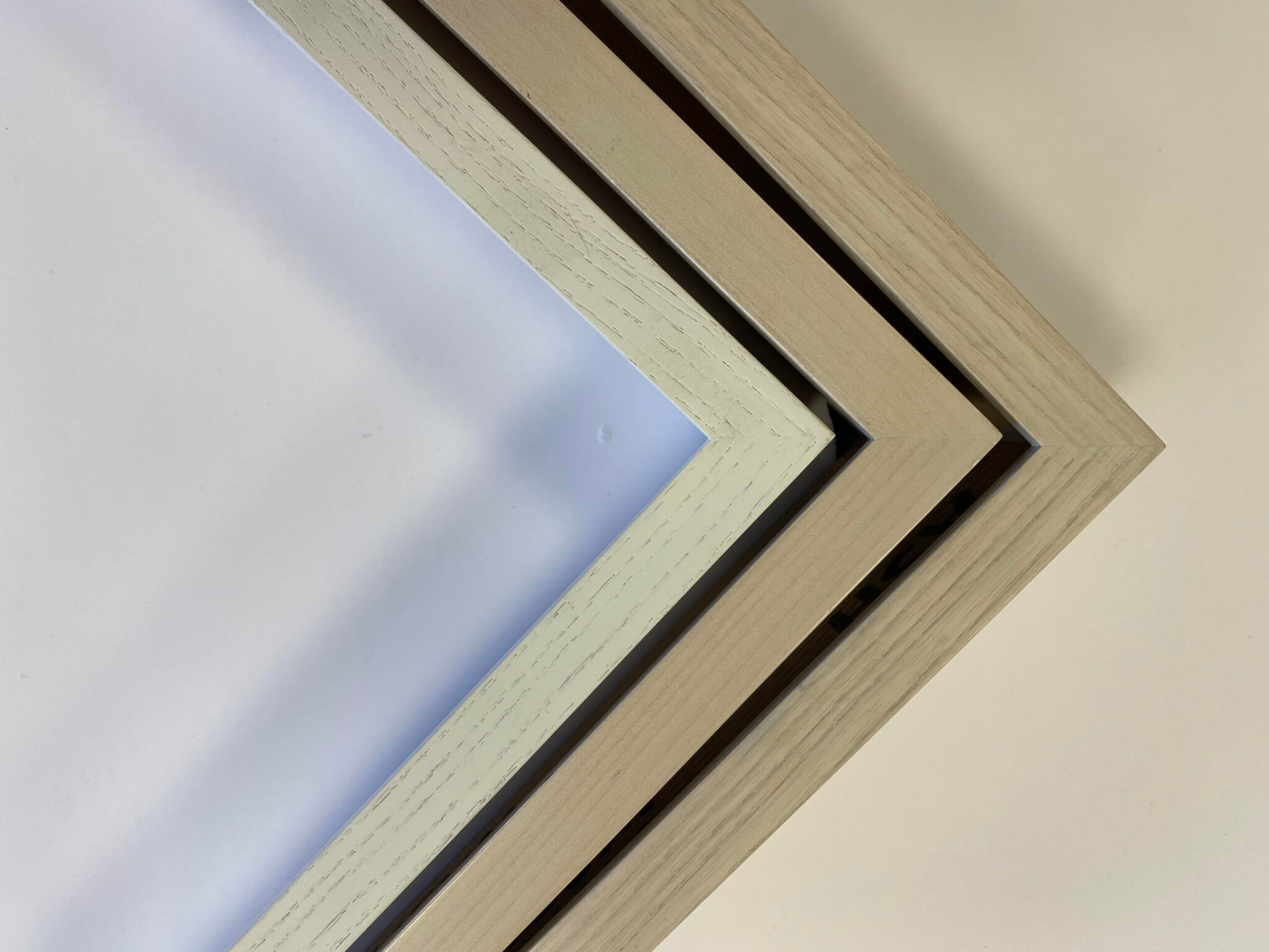 custom white finished picture frames, custom pickled finish frames, white wash maple custom frames chicago
