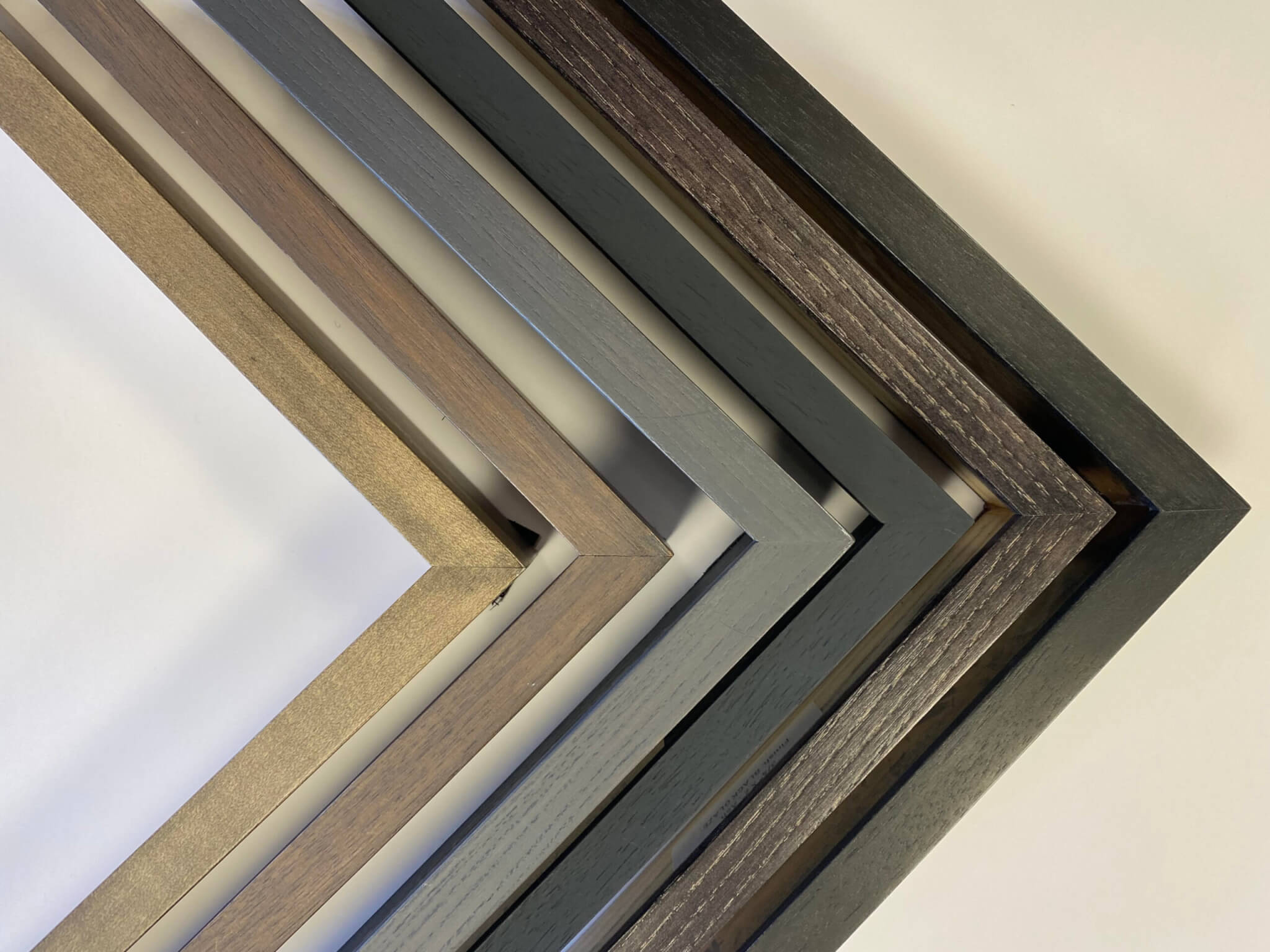 Collection of black finished custom corner gallery frames