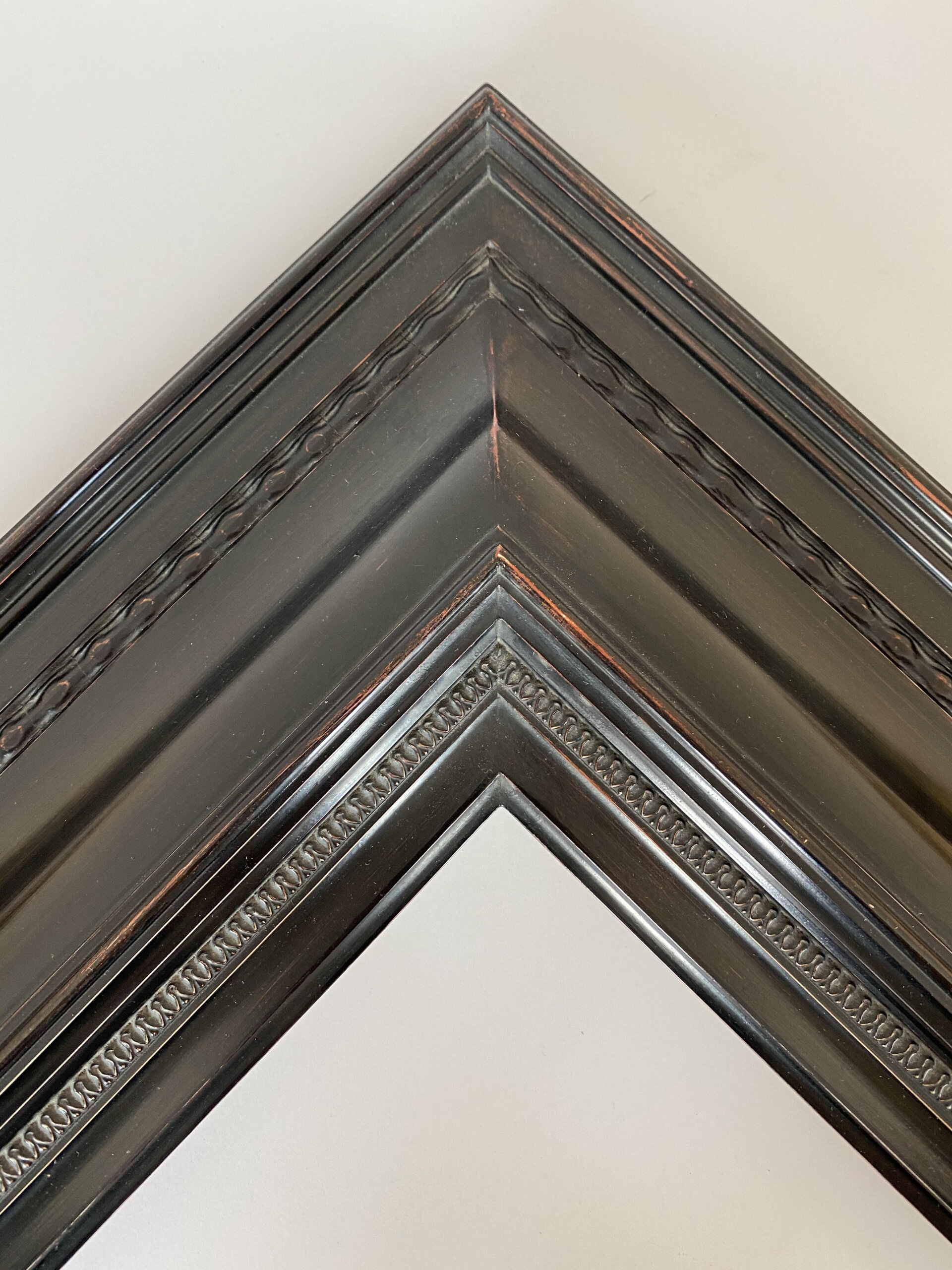 Antique Black with red rub finish on a reproduction turn of the century revival dutch frame