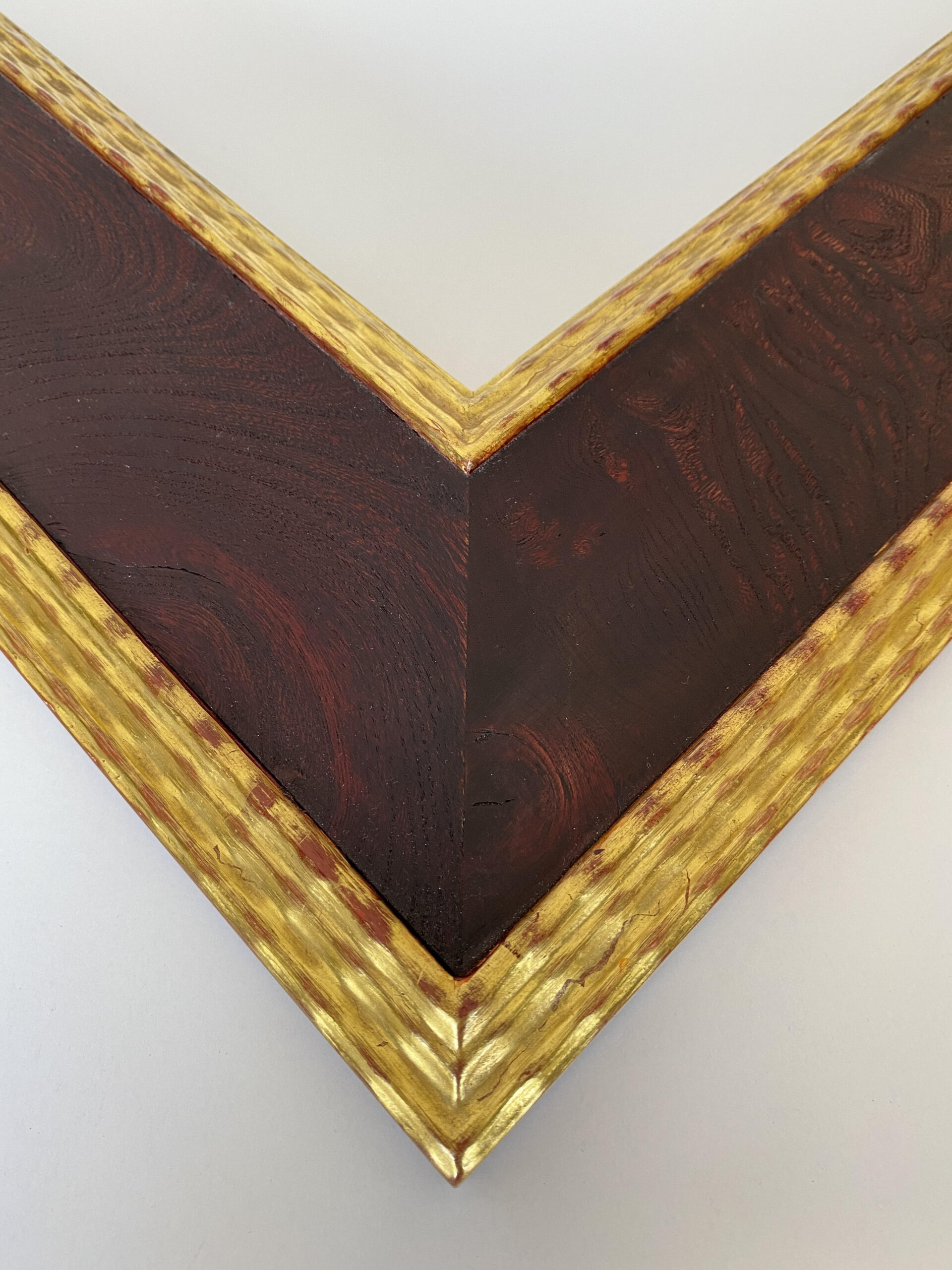 Red finsihed burled wood panel with 22k gilt lip and exterior edge. Artifact services custom frames. Artmill Group chicago