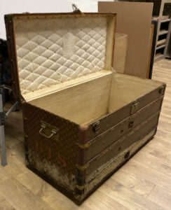 Antique Louis Vuitton Tall Ladies Steamer Trunk Before Conservation Antique trunk restoration Chicago Conservation Chicago Provenance conservation Antique restoration Antique conservation Trunk repair Louis Vuitton Trunk repair Antique Water restoration Artifact services Chicago Artmill Group Armand Lee The Repair Shop Chicago Artifact services claim restoration Antique repair Fine art conservation Heirloom Restoration Art conservation services Water damage restoration April Hann Lanford