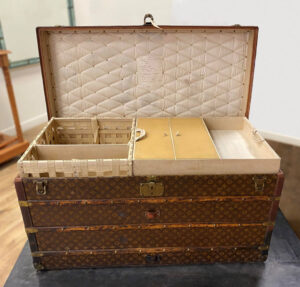 Antique Louis Vuitton Tall Ladies Steamer Trunk After Conservation Before After treatment Antique trunk restoration Chicago Antique restoration Antique conservation Trunk repair Louis Vuitton Trunk repair Antique Water restoration Artifact services Chicago Artmill Group Armand Lee Furniture restoration The Repair Shop Chicago Antique repair Fine art conservation Heirloom Restoration Water damage restoration Specialty contents conservation Insurance claims