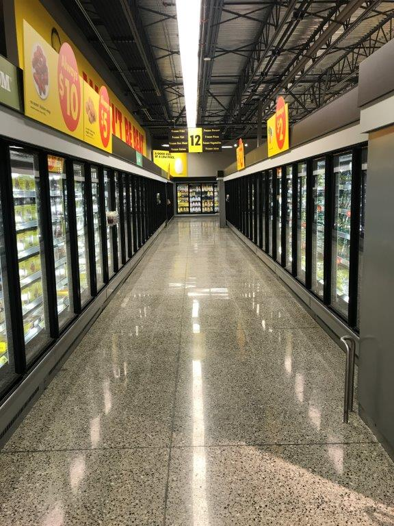 Completed Commercial Tenant Improvement project by Outline Millwork for No Frills Grocery Store in Abbotsford, BC featuring custom commercial millwork, custom cabinetry & woodworking.