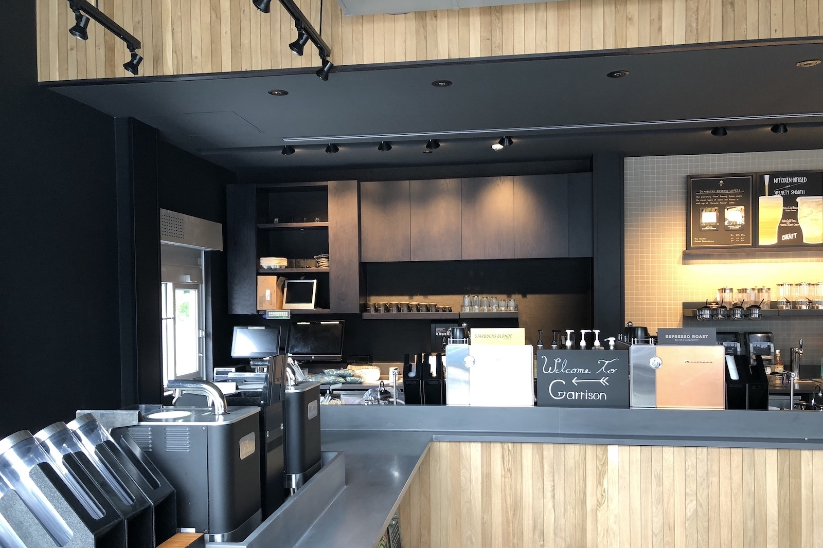 Completed Commercial Tenant Improvement project by Outline Millwork for Starbucks at Garrison Crossing in Chilliwack, BC featuring custom commercial millwork, custom cabinetry & woodworking.