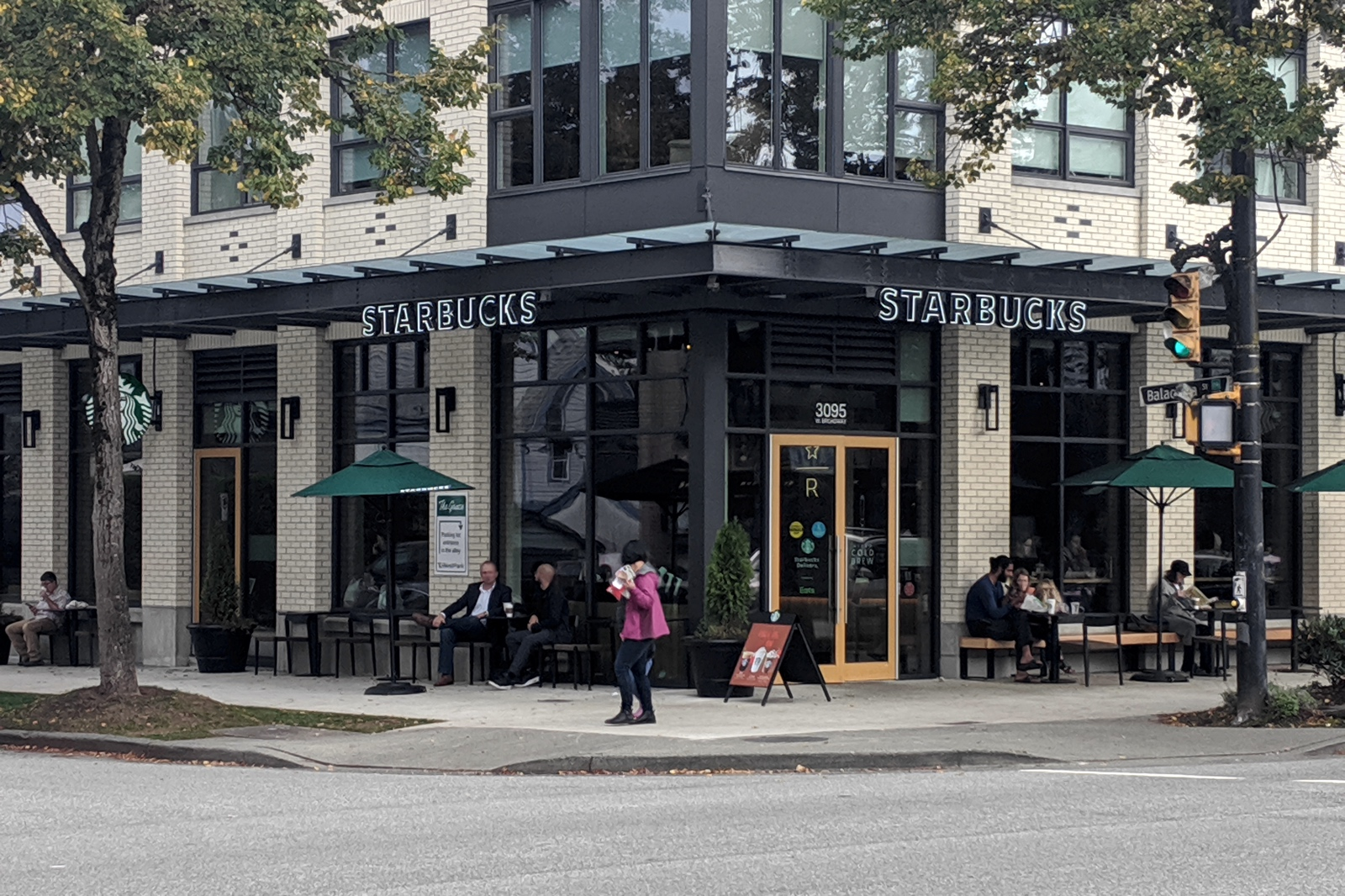 Completed Commercial Tenant Improvement project by Outline Millwork for Starbucks West Broadway Vancouver, BC featuring custom commercial millwork, custom cabinetry & woodworking, and commercial fixtures.