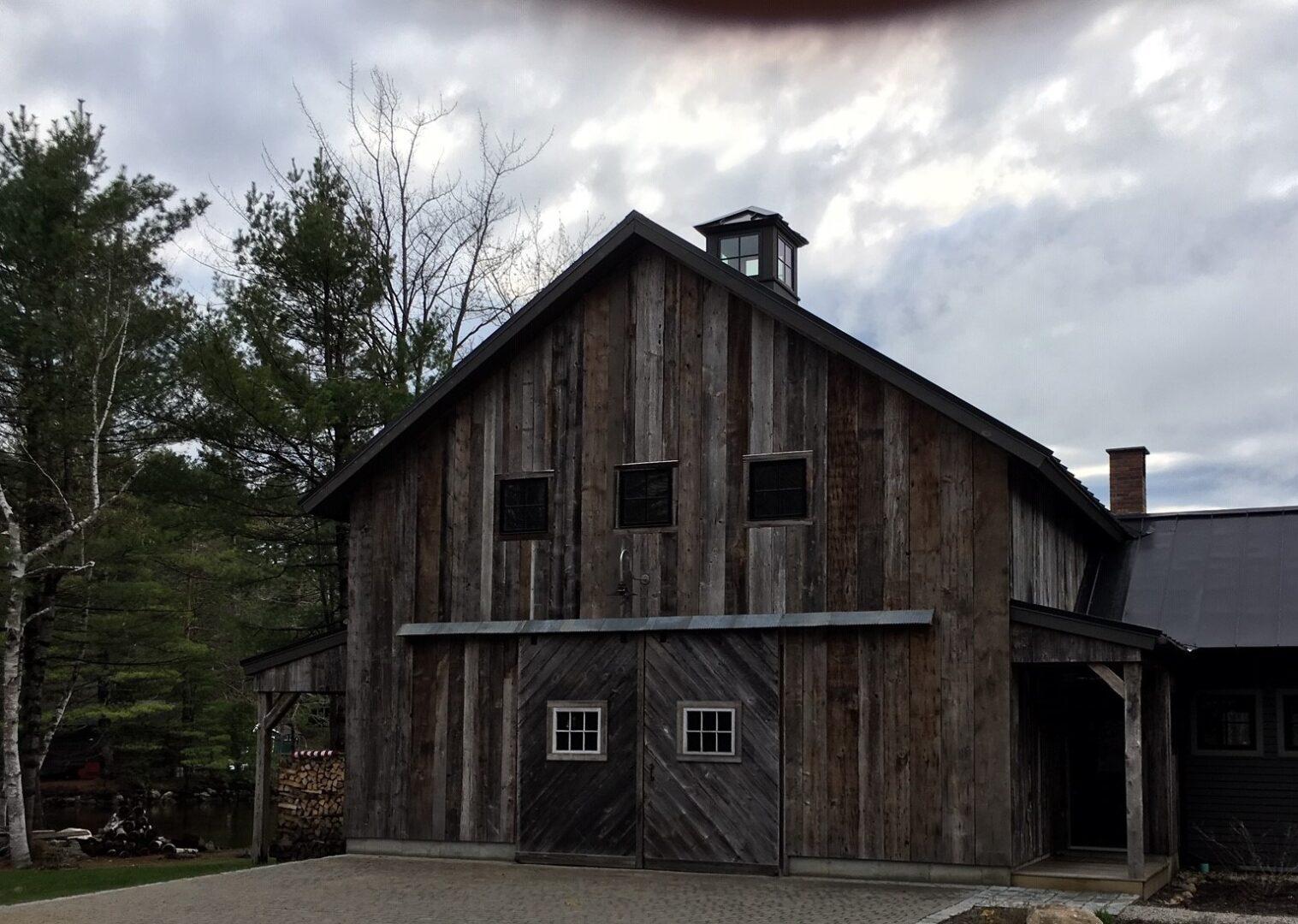 Renovated garage with upstairs Game Room using seasoned barn boards