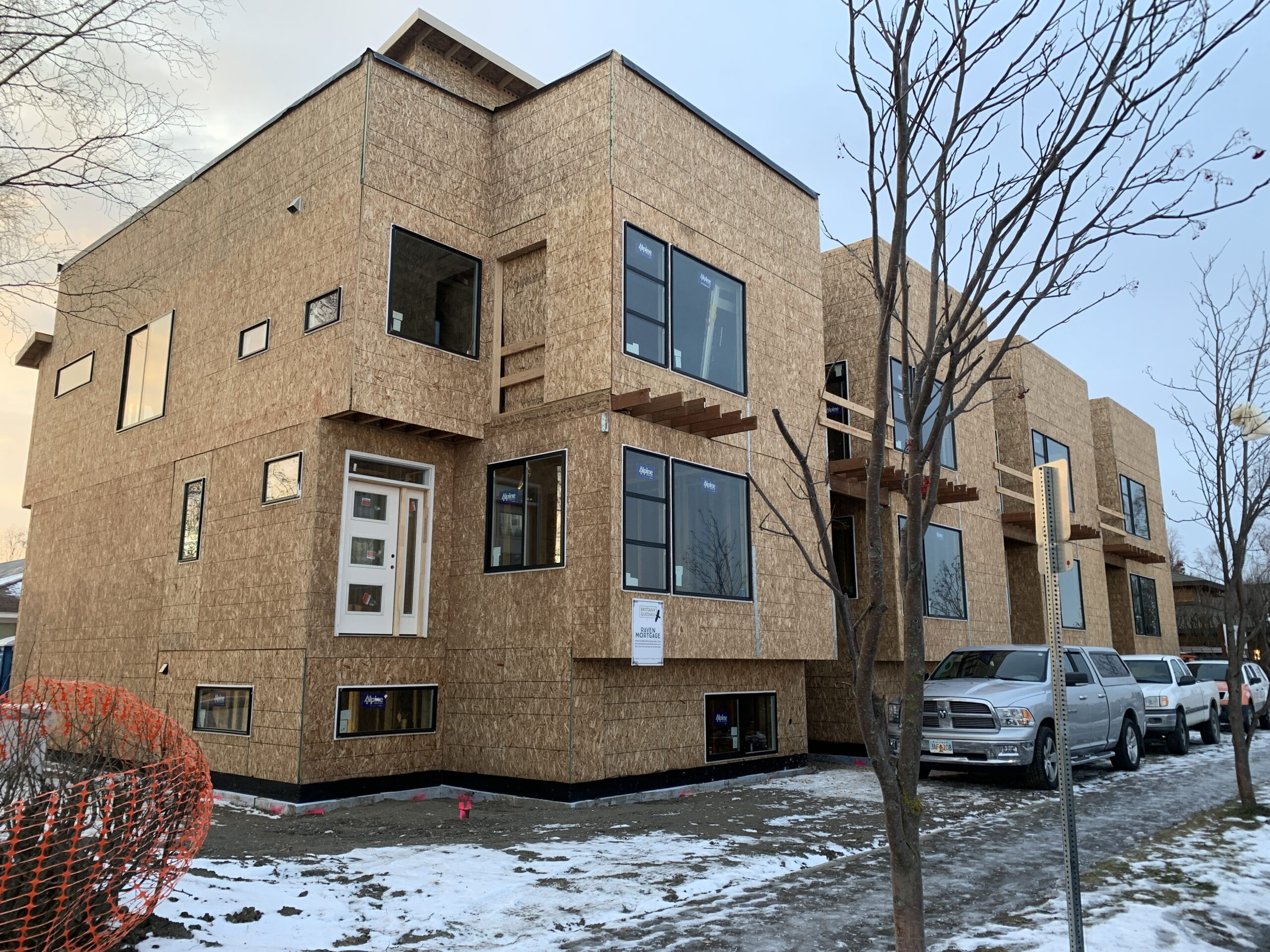 Contemporary townhouses along Delaney Park are nearing completion