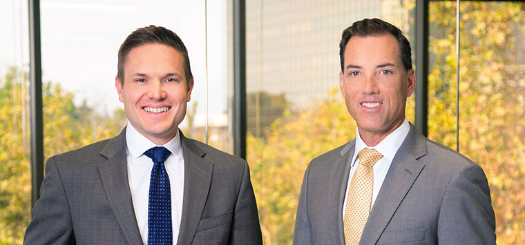 Michael and Jeff announcing law firm name change