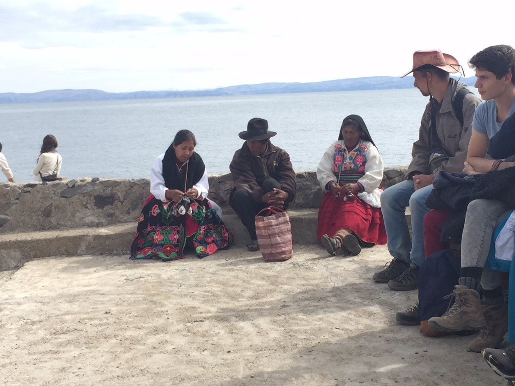 Maritza sitting with her mother and father