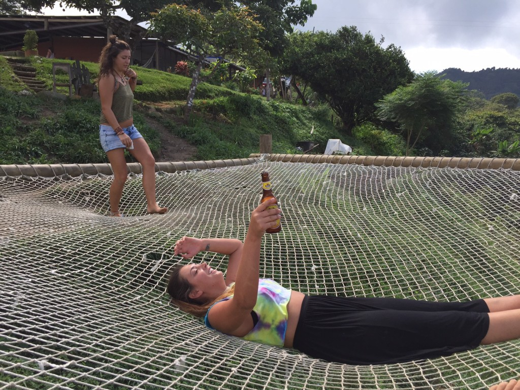 Visitors to Casa Elemento relax on the giant hammock.