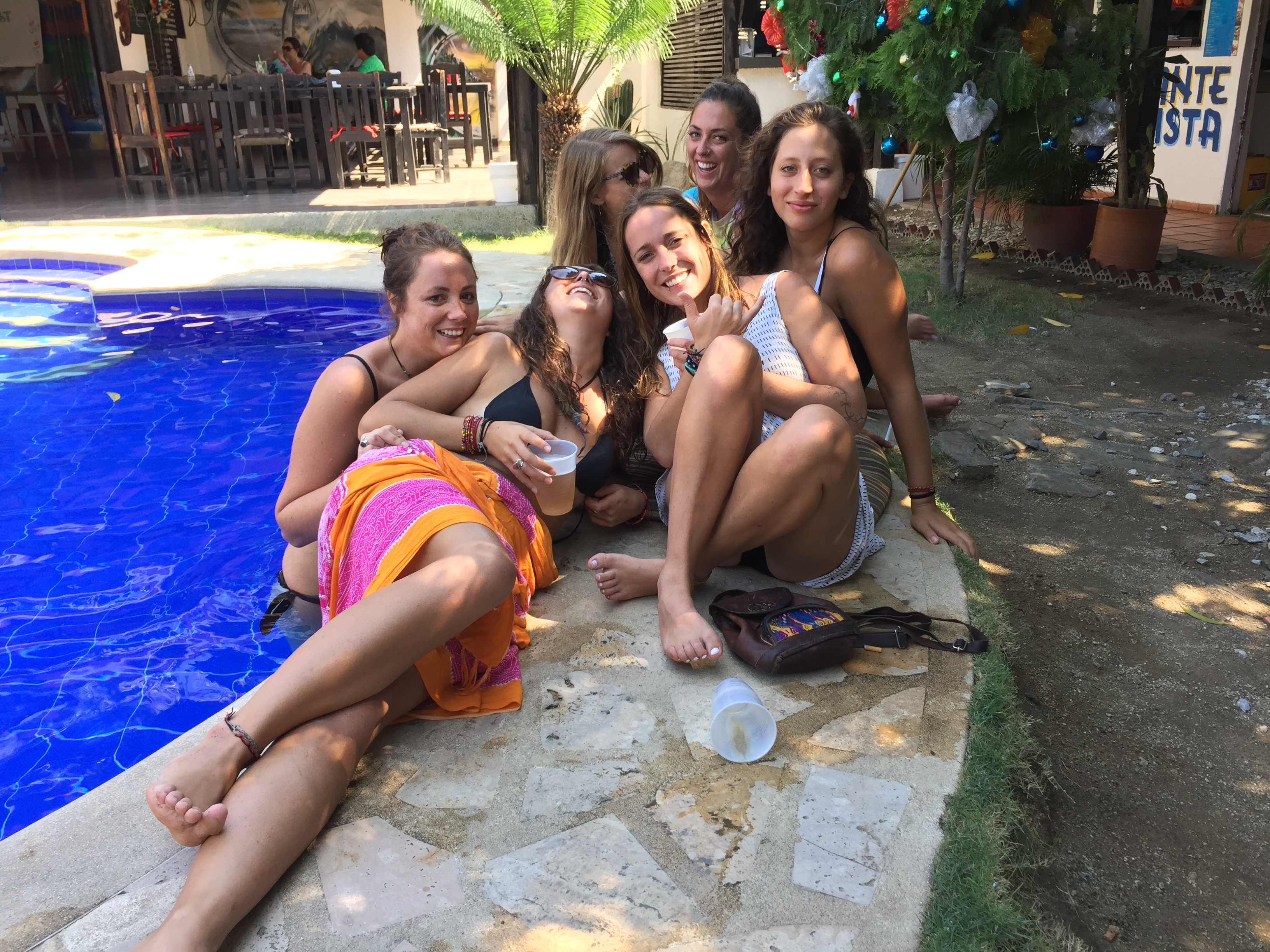 girls hanging by the pool at Dreamers Hostel, Santa Marta, Colombia