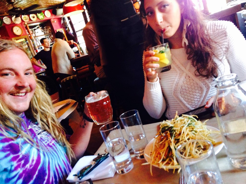 whiskey smash and cask beer over shoestring fries at the Spotted Pig