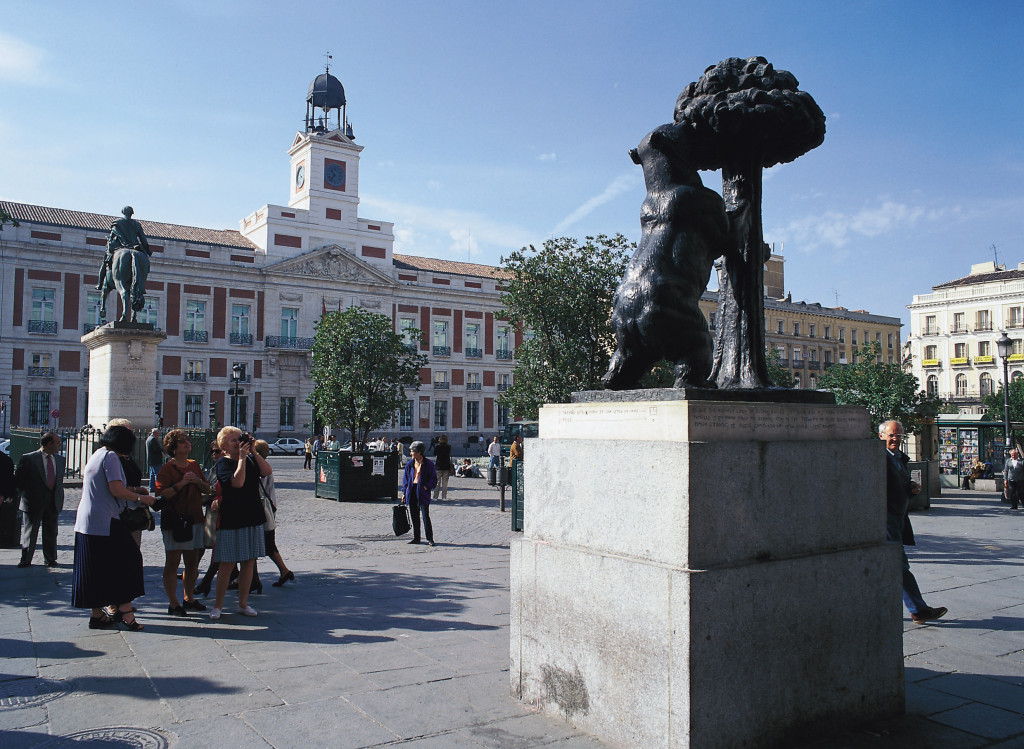 Statue of Madrid sigil of bear and strawberry tree, Puerta del Sol, Spain