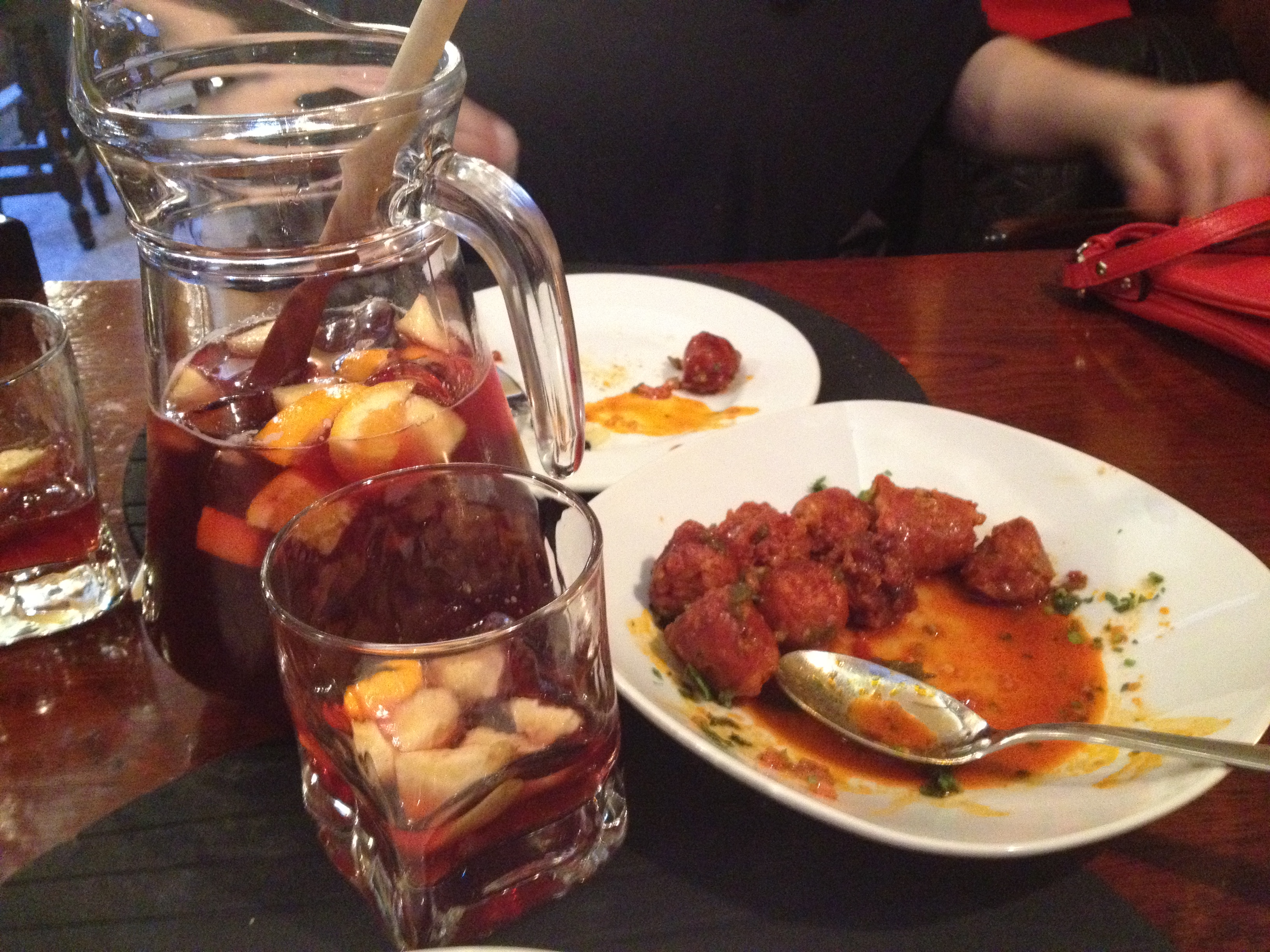 tapas of chorizo with jarra of red sangria in Madrid, Spain