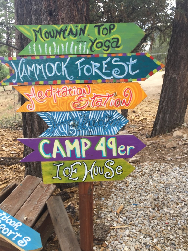 Signs pointing to activity stations in ITH Big Bear Mountain Adventure Lodge's grounds.