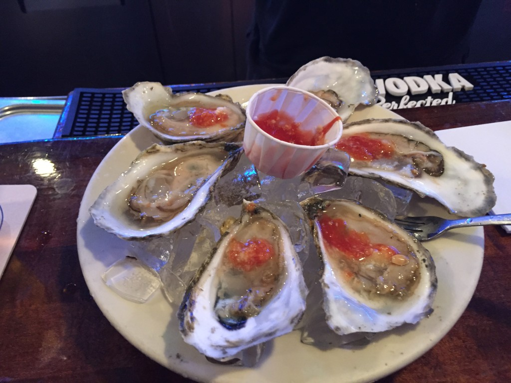 Freshly shucked oysters with some cocktail sauce from The Salty Dog in Faneuil Hall