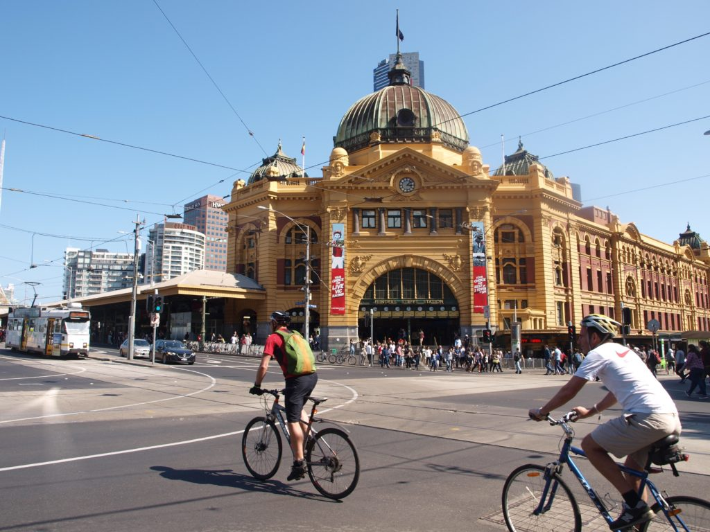 Facade of Flinders Street Station on sunny day in Melbourne