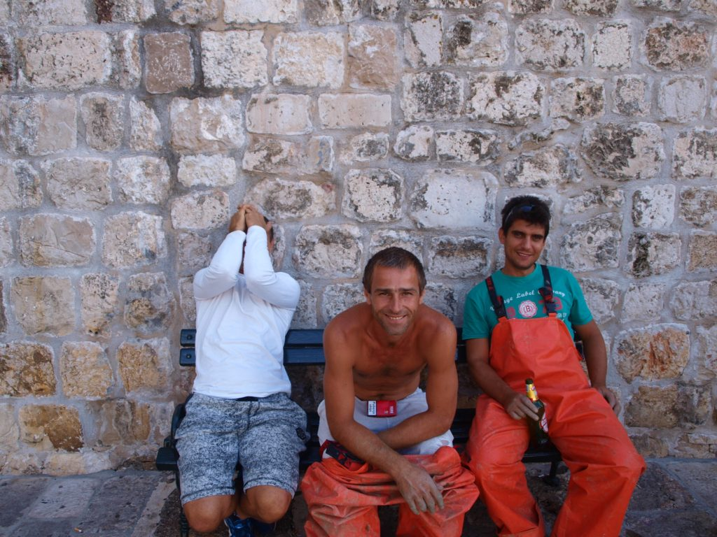 Fishermen on bench in Dubrovnik