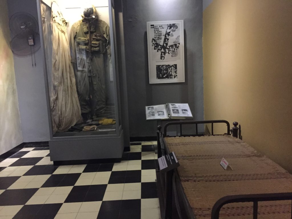 Cot and uniform for American pilots and prisoners of war during Vietnam War, Hoa Lo Prison, Hanoi, Vietnam