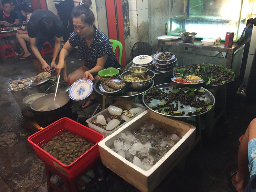 Street chef, shellfish, Hanoi, Vietnam