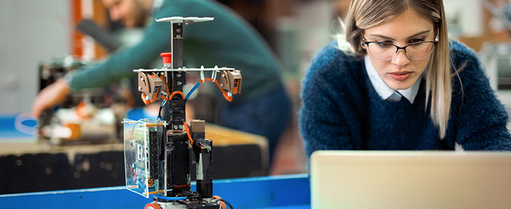 Young woman working in robotics