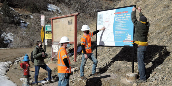 Installation of larger sign in Transfer Trail parking lot