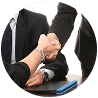 hands shaking in trust over a legal agreement