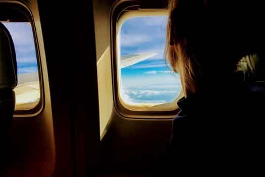 girl looking out plane window