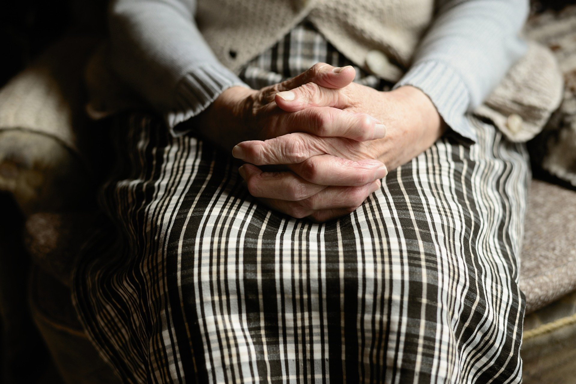 Image of a senior person's hands symbolizing vulnerability to undue influence