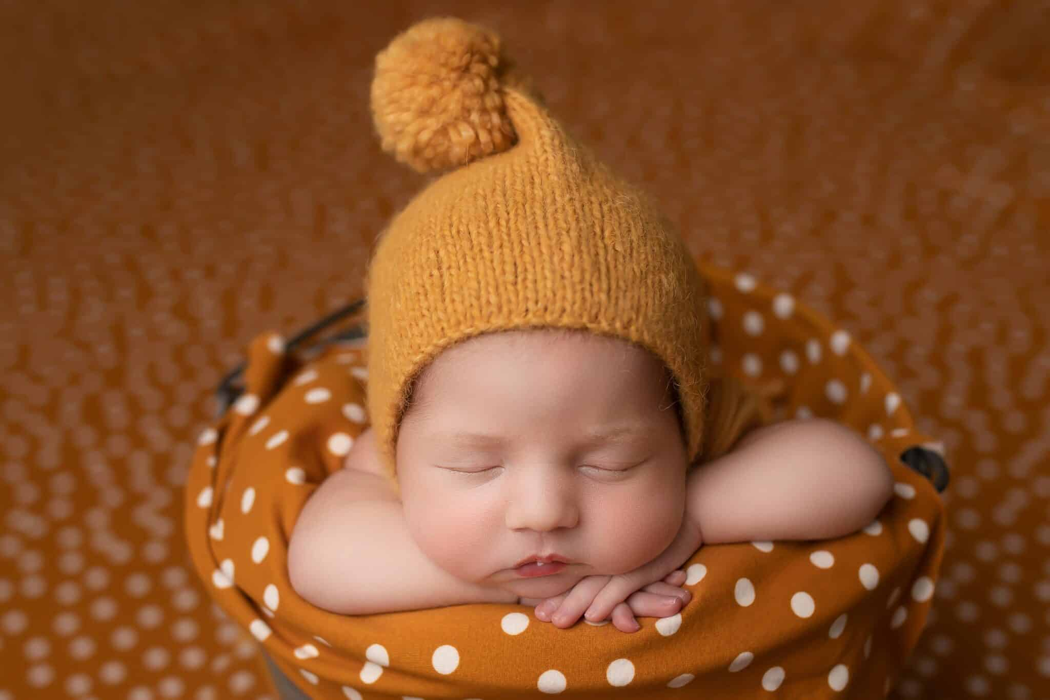 Yellow pom pom hats are simply adorable.