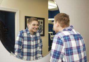 patient smiling in mirror