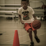 kid working on dribbling