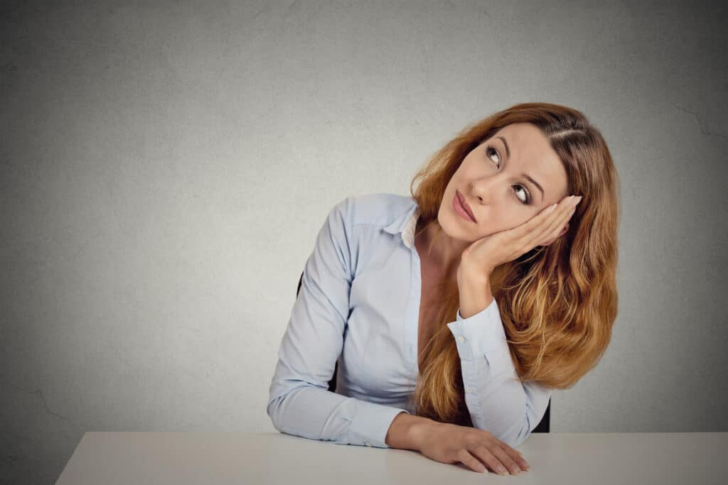 Woman daydreaming a classic sign of ADHD in women