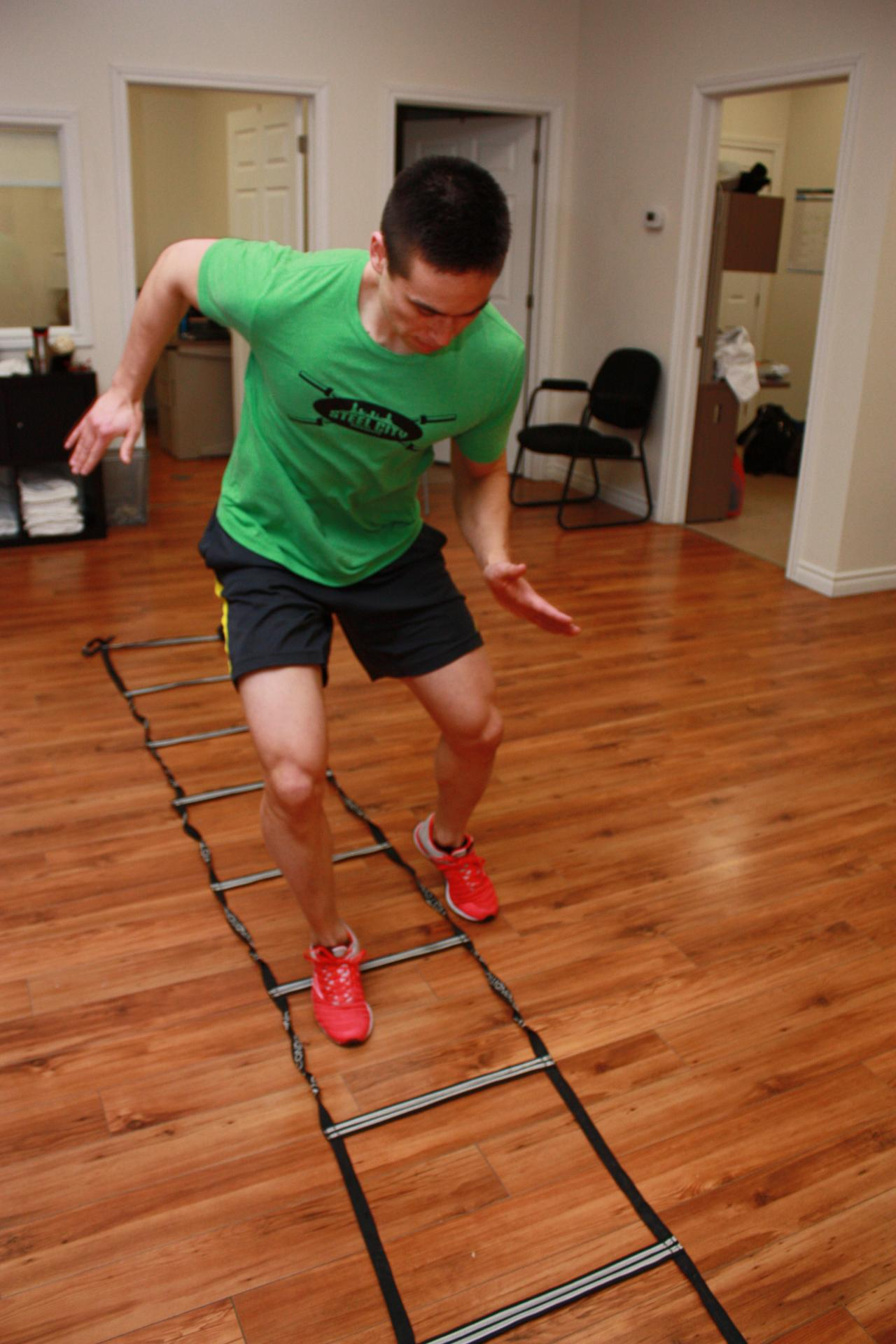 patient running ladder drill for strength and conditioning