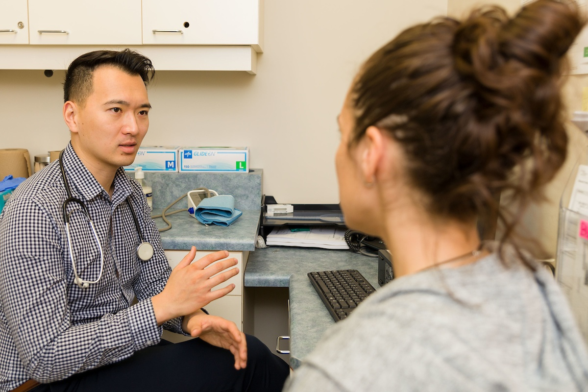 sports medicine physician discussing with a patient